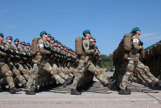 Members of the Ukrainian Army begin a troop exercise. The U.S. Defense Department announced $250 million in support to Ukraine on Tuesday, which includes lethal weapons and military training. Photo courtesy of the Ukrainian Defense Ministry