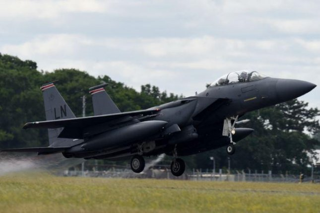 An F-15 leaves RAF Mindenhall, Britain, to participate in Large Force Exercises at Spangdahlen Air Base, Germany, on July 1, 2020. Photo by Sr. Airman Christopher Sparks/U.S. Air Force