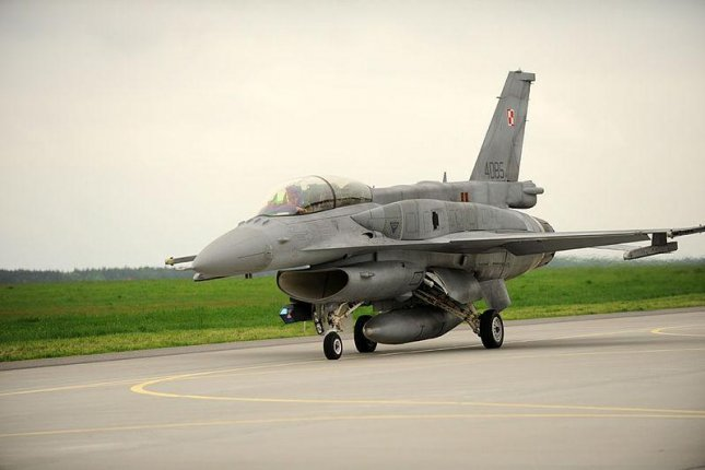 L-3 Link is to support training devices for Polish Air Force F-16 crew. U.S. Air Force photo of Polish F-16 by TSgt Kenya Shiloh