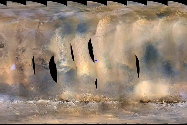 A global map of Mars, compiled using the Mars Color Imager camera on NASA's Mars Reconnaissance Orbiter, shows the growing dust storm. The blue dot marks Opportunity's position inside Perseverance Valley. Photo by NASA/JPL-Caltech/MSSS