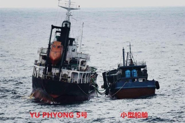 Tokyo issued this photo of a North Korean ship (L) refueling at sea with the assistance of another vessel in June. File Photo courtesy of Ministry of Foreign Affairs of Japan