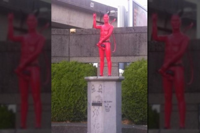 A mysterious statue of a randy devil sporting a full erection appeared Tuesday in Vancouver. (Reddit)