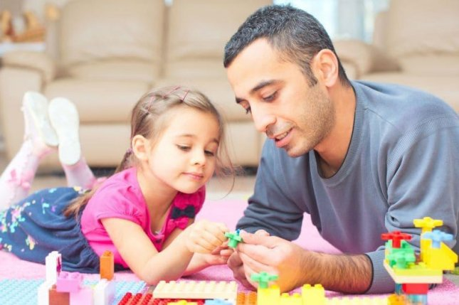 About half of American fathers say they have been criticized about their parenting. Photo courtesy of HealthDay News
