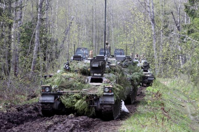 A British armored vehicle practices during a military exercise near Sillamae, Estonia, on May 7. File Photo by Valda Kalnina/EPA-EFE