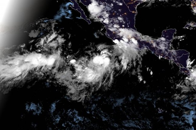 Tropical Storm Cristina, at center, this week is expected to become the first hurricane of the Atlantic or Pacific season. It is not, however, expected to make landfall anywhere. Image courtesy NOAA/NHC