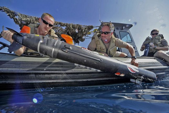 U.S. Navy personnel launch an MK 18 MOD 2 Swordfish unmanned underwater vehicle to survey the ocean floor. U.S. Navy photo by Mass Communication Specialist 1st Class Blake Midnight