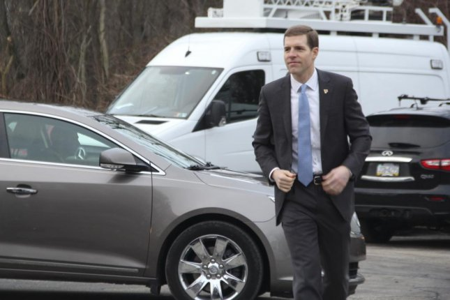 Democrat Conor Lamb, arriving to vote Tuesday morning, leads Republican Rick Saccone by 627 votes -- a margin of 0.3 percentage points. Lamb declared victory early Wednesday morning, but Saccone has refused to concede. Photo by Eric Miller/MNS/UPI