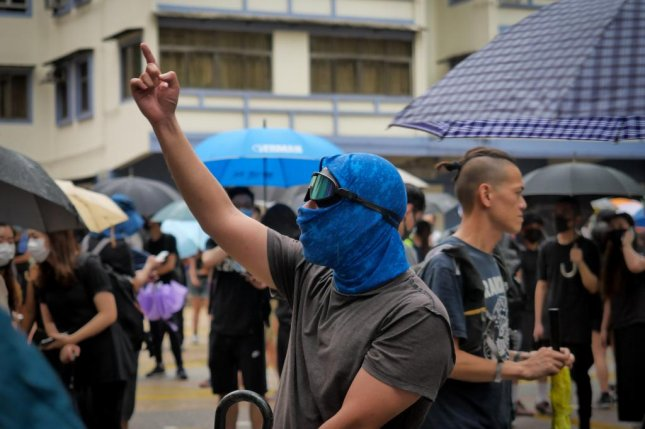 A protester shouts slogans during an anti-government rally in Hong Kong on Saturday, the 11th straight weekend demonstrations have been held. Photo by Thomas Maresca/UPI