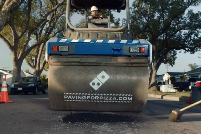 Domino's is partnering with U.S. cities to fill potholes as a means to avoid irreversible damage to pizza. Photo courtesy of Domino's