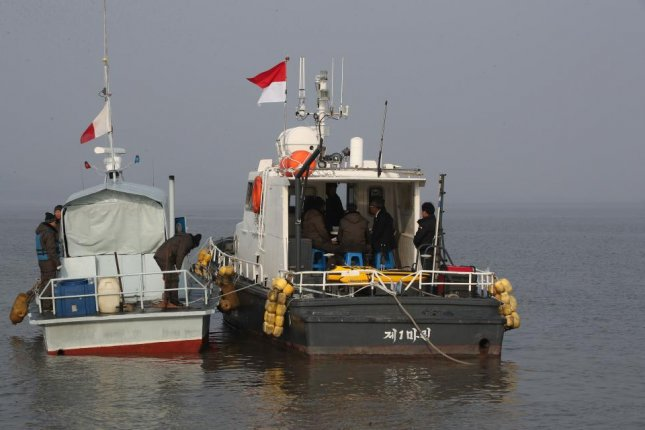 Survey teams of the two Koreas hold a meeting on a ship at the mouth of the Han River near Gyodong Island in Incheon, west of Seoul, on Nov. 5, 2018. Pool Photo/Yonhap