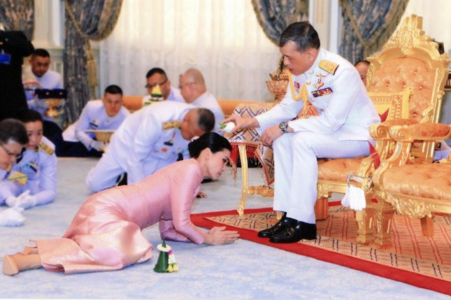 Thai King Maha Vajiralongkorn Bodindradebayavarangkun (R) pours wedding water on Ge. Suthida Vajiralongkorn Na Ayudhya (L) who is now appointed as Queen Suthida during a royal marriage registration ceremony at the Amphorn Sathan Residential Hall inside the Dusit Palace in Bangkok, Thailand. Photo by EPA-EFE/ROYAL HOUSEHOLD BUREAU