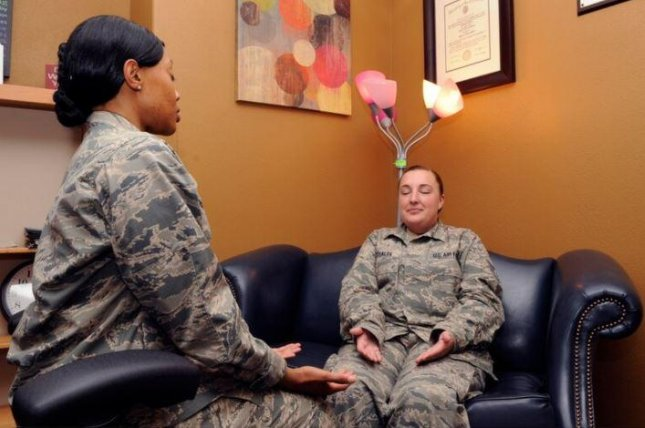Maj. Crystal McLeod, L, and Staff Sgt. Rebecca Michalek, R, demonstrate relaxation training as stress relief at Vandenberg Air Force Base, Calif. Photo by Sr.r Airman Shane Phipps/U.S. Air Force
