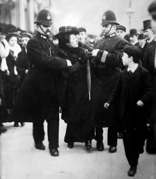 A supporter of women's rights is arrested during a demonstration in London ca. 1910. Photo courtesy Library of Congress