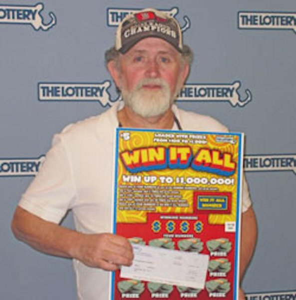 Kevin Phillips of Lakeview, Massachusetts won his second $1 million dollar prize from the Massachusetts State Lottery after purchasing a $5 Win It All instant win ticket. His first win came in 2014 and he chose the one-time payment of $650,000 in both instances. Photo courtesy of Massachusetts State Lottery