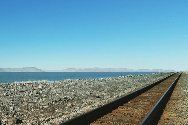 A railroad causeway separates the Great Salt Lake into two arms, one of which is far saltier than the other. Photo by University of Utah