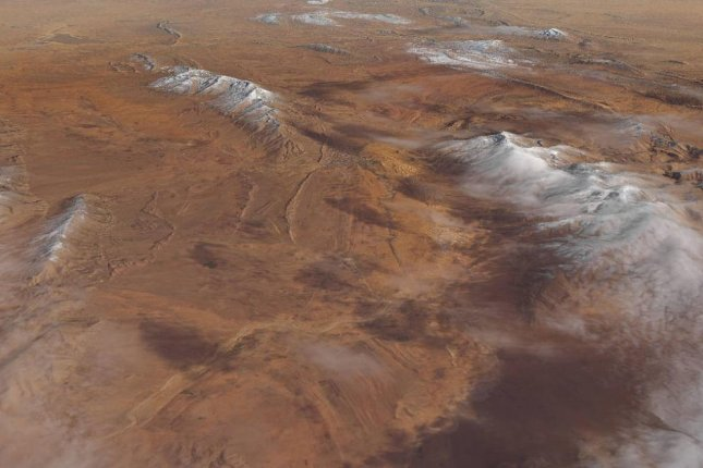 The snow-capped dunes were photographed by NASA's LandSat 8 satellite. Photo by NASA
