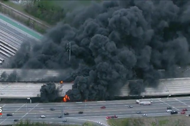 Fire investigators arrested three people in connection to a massive fire on a heavily traveled section of an Atlanta overpass. Screenshot from Fox 5