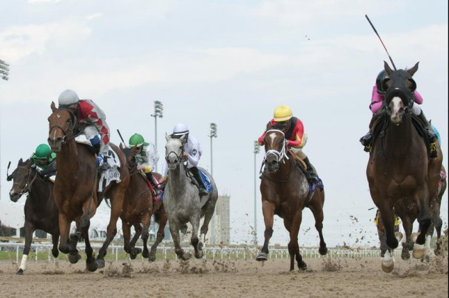 Code Warrior, far right, wins Sunday's Grade III Hendrie Stakes at Woodbine with Anne Sanguinetti riding for her parents' stable. Photo courtesy Woodbine.