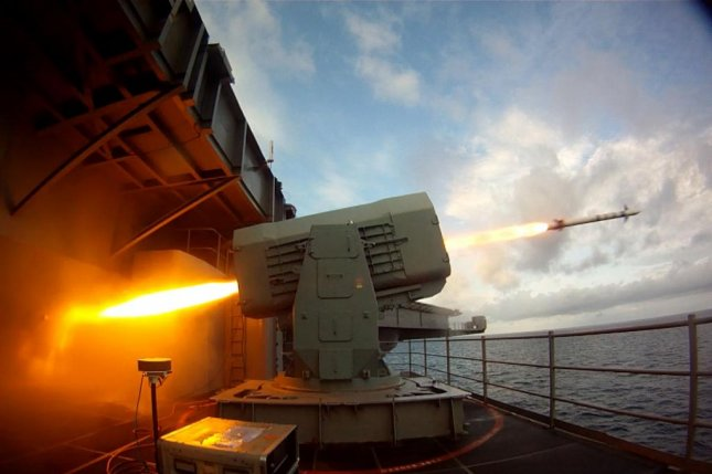 The aircraft carrier USS Theodore Roosevelt launches a Rolling Airframe Missile in the Atlantic Ocean on August 19, 2014. Photo courtesy U.S. Navy/Flickr