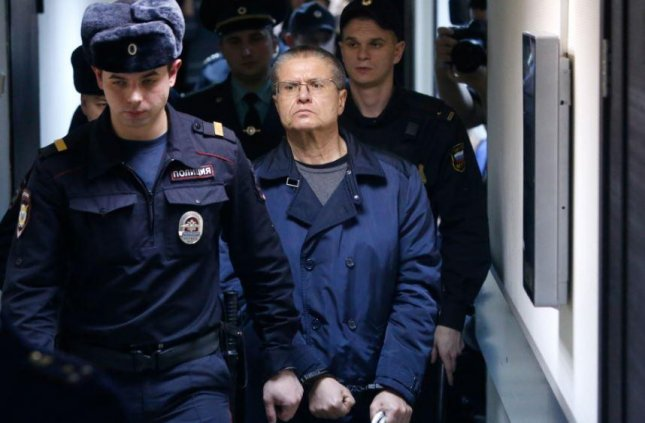 Alexei Ulyukayev, C, Russian President Vladimir Putin's former economic minister, is escorted from court on Friday after a bribery conviction. He received an eight-year prison sentence. File Photo by Sergei Chrikov/EPA-EFE/UPI