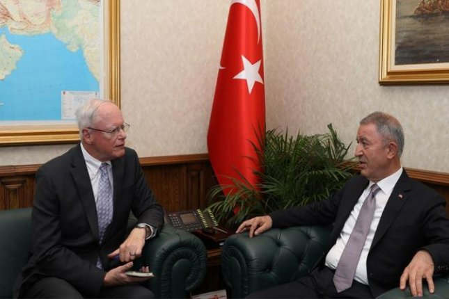 After Turkish Defense Minister Huusi Akar, L, met with U.S. Special Envoy to Syria James Jeffrey, R, in Ankara this week, an agreement was announced to postpone Turkish invasion of Syria. Photo courtesy of Turkish Defense Ministry