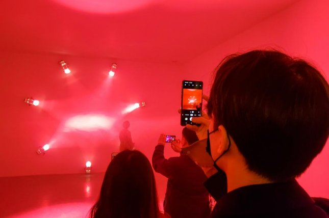 Spectators take in Rose, an installation by Brussels-based artist Ann Veronica Janssens at the launch of the Seoul chapter of Connect, BTS, a five-city global art exhibition at Dongdaemun Design Plaza in Seoul on Tuesday. Photo by Thomas Maresca/UPI