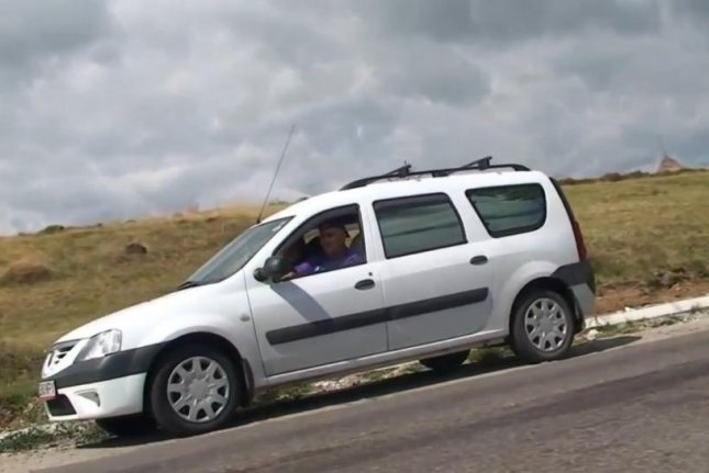 A car in neutral rolls up a so-called gravity hill in Romania. Rumble video screenshot