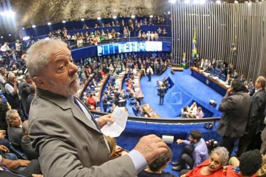 Former president of Brazil Luiz Inacio Lula da Silva, seen here in late August within Brazil's Federal Senate chambers, is facing additional corruption and money laundering charges for allegedly receiving about $22 million in bribes related to the Petrobras scandal. Lula faces two other separate corruption charges; one for corruption and money laundering related to an apartment and a construction contract in Angola, and another for obstruction of justice. File Photo courtesy of Luiz Inacio Lula da Silva