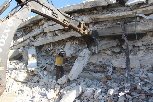 Volunteers from the Syrian rescue group the White Helmets worked to rescue residents of a building in the Syrian town of Sarmada on Sunday after a blast originating from an ammunition depot belonging to an arms dealer killed 39 people. Photo courtesy The White Helmets