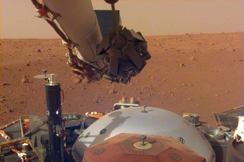 NASA's flexed robotic arm is preparing to deploy its two main instruments. Photo by NASA/JPL-Caltech