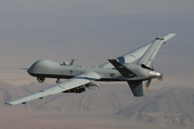 The MQ-9 Reaper, shown in a combat mission over southern Afghanistan, is a remotely powered aircraft that is manufactured by General Atomics Electromagnetic Systems. Photo by Lt. Col. Leslie Pratt/U.S. Air Force