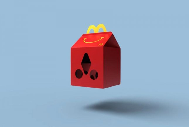 A Happy Meal box in the process of transforming into Happy Goggles. Screenshot: McDonald's Sverige/YouTube