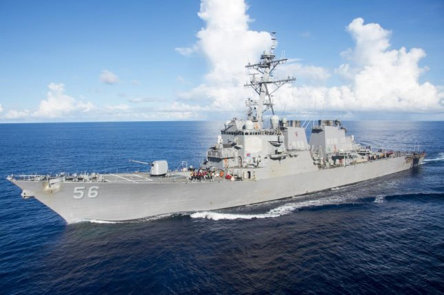 United States  warship sails close to South China Sea island, China 'displeased'