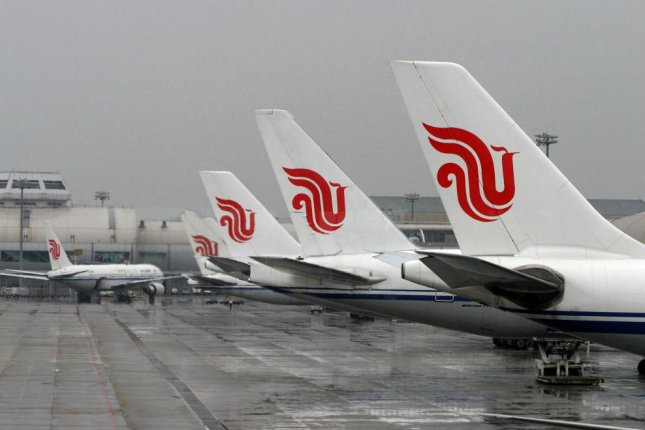 A view of Air China aircraft sit on the tarmac at Capital Airport in Beijing, China. Photo by David Mcintyre/EPA