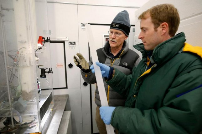 Joe McConnell, lead study author, and Nathan Chellman, a doctoral student at the Desert Research Institute, examine an Arctic ice core in DRI's Ultra-Trace Ice Core Chemistry Laboratory in Reno, Nevada. Photo by DRI