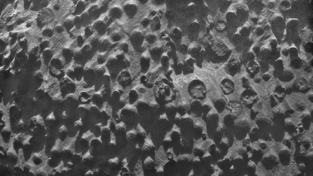 Small spherical objects fill the field in this mosaic combining four images from the Microscopic Imager on NASA's Mars Exploration Rover Opportunity. The view covers an area about 2.4 inches (6 centimeters) across, at an outcrop called Kirkwood in the Cape York segment of the western rim of Endeavour Crater. The individual spherules are up to about one-eighth inch (3 millimeters) in diameter. Image credit: NASA/JPL-Caltech/Cornell Univ./ USGS/Modesto Junior College