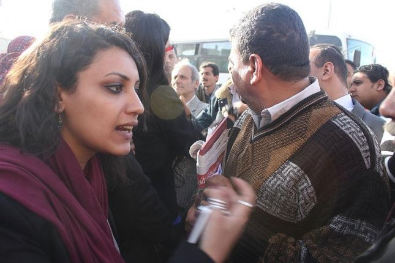 An Egyptian woman gestures on International Women's Day 2011. (Al Jazeera English)