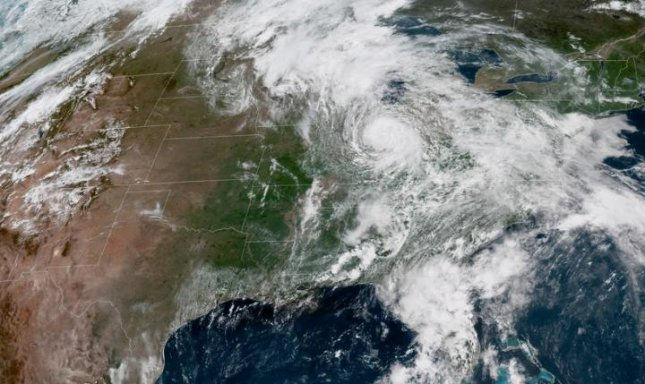 Tropical Depression Alberto moves north in this satellite image from the National Weather Service Wednesday. Forecasters said the storm triggered a flash flood emergency in North Carolina. Image courtesy NOAA/NHC