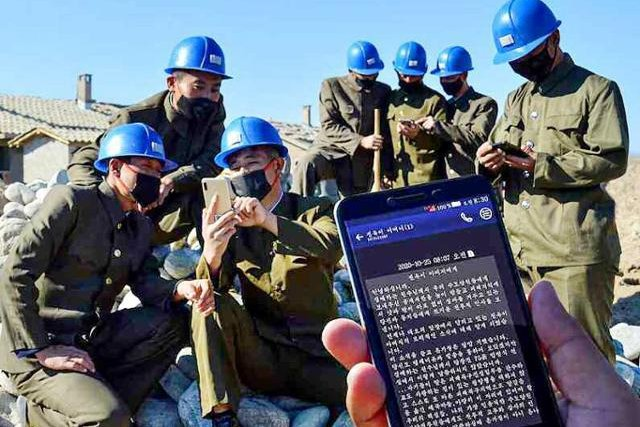 North Korean volunteers are receiving texts as they work on disaster relief projects, the Rodong Sinmun said Tuesday. Photo by Rodong Sinmun