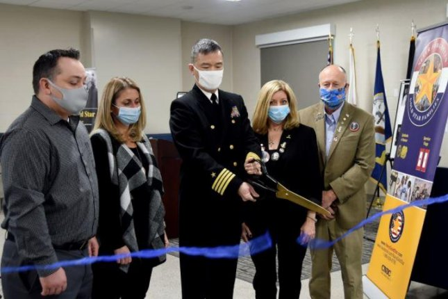 Capt. Raymond Leung, C, ceremonially opened barracks at Great Lakes Naval Station, Ill., on Tuesday named after the USS John S. McCain, the ship's three namesakes and the 10 sailors who died aboard the ship in a 2017 collision. Photo courtesy of Naval Station Great Lakes