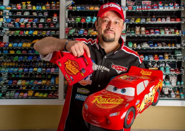 Jorge Arias of Mexico City collected 1,200 pieces of memorabilia related to Disney-Pixar movie Cars, earning a Guinness World Record in the process. Photo courtesy of Guinness World Records