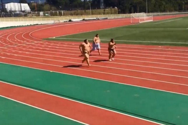 Sumo wrestlers sprint on a Japanese track. Storyful video screenshot