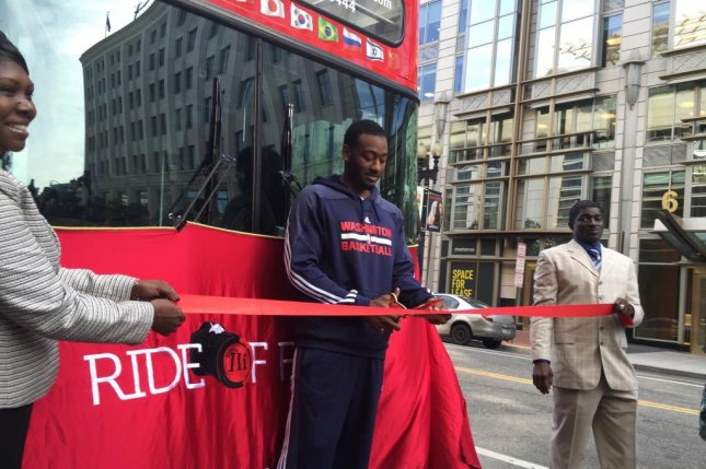 John Wall, the two-time NBA All-Star point guard for the Washington Wizards, was honored with a seat on the Ride of Fame tour bus in Washington, D.C. Oct 26, 2015. Photo by Connor Morgan/MNS/UPI