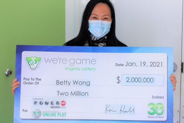 Betty Wong, of McLean, Va., said she accidentally bought 50 quick-pick tickets for a single Powerball drawing and ended up winning $2 million. Photo courtesy of the Virginia Lottery