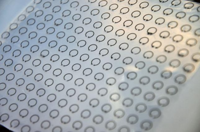 A stretchable meta-skin cloaking technology uses rows of tiny ring resonators help to trap radar waves. Photo by Liang Dong/ISU
