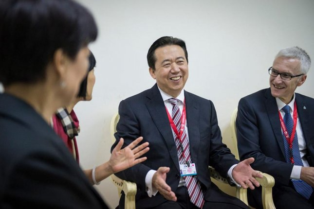 Meng Hongwei, center, disappeared September 25 and Chinese authorities said Monday he's under investigation for allegedly accepting bribes. Photo by Interpol/EPA-EFE