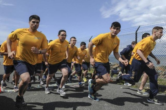 Navy personnel at Naval Station Everett, Wash., conduct a physical fitness assessment. The autumn assessment was canceled by the Navy to avoid the spread of the COVID-19 virus. Photo by MCS Eli K. Buguey/U.S. Navy