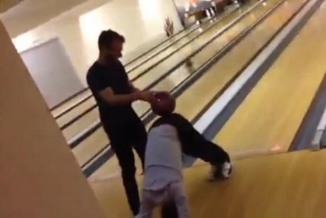 Daniel Berg and a friend invent a new sport combining yoga and bowling. Storyful video screenshot