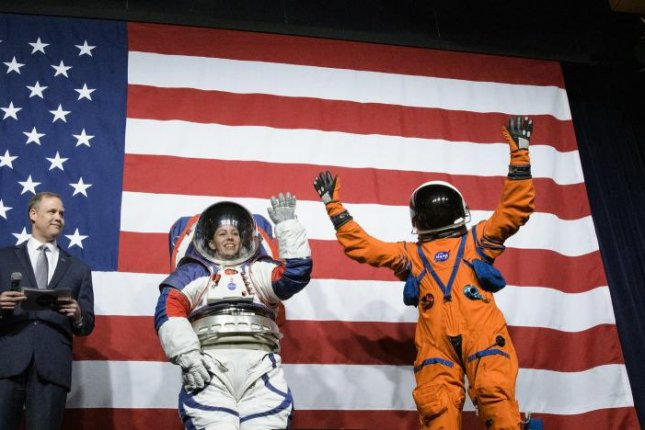 Kristine Davis and Dustin Gohmert wear prototype spacesuits unveiled Tuesday, which are designed for NASA's return to the moon and exploration of Mars, Photo courtesy Joel Kowsky/NASA/UPI