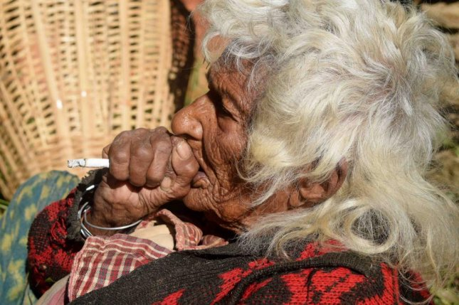 A 112-year-old Nepalese woman says she has been smoking 30 cigarettes each day for the past 95 years. Screenshot: Storyful